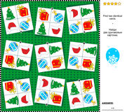 Christmas or New Year visual riddle - find two identical cards with holiday symbols. Christmas or New Year holiday themed visual logic puzzle: Find the two Stock Photography