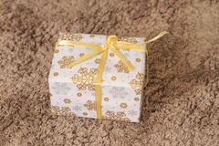 Christmas and New Year white gift under the tree on the rug Royalty Free Stock Photos
