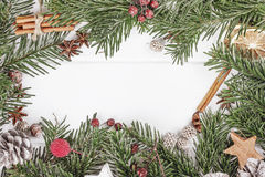 Christmas or New Year white wooden background, board framed. With season decorations, space for a text royalty free stock photo
