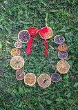 Christmas, New Year winter holiday composition. Decor of dried orange slices. Decor of dried orange slices and red bow on green grass. Christmas, New Year winter royalty free stock image