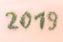 Christmas, New Year winter holiday composition. 2019 numbers made of green fir-tree branches. Christmas, New Year winter holiday festive composition. 2019 royalty free stock images