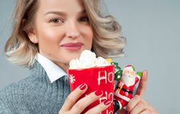 Christmas and New Year. Woman is drinking hot coffee. Royalty Free Stock Photo