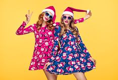 Christmas New Year. Woman in Santa hat Having Fun. Christmas New Year. Young Woman in Santa Claus hat Dance, Having Fun. Fashion Sunglasses. Pretty Playful Stock Photography