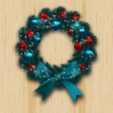Christmas and New Year wreath. Blue branch of fir with red, blue balls and blue bow on wood background. Christmas cards Royalty Free Stock Photos