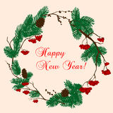 Christmas and New Year wreath with red berries. Christmas and New Year decorative wreath composed with pine and viburnum trees branches, adorned by cones and Royalty Free Stock Photo