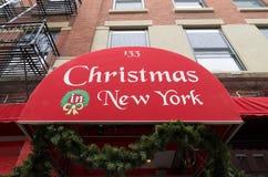 Christmas in new york canopy. NEW YORK - APRIL 29, 2016: Red canopy with christmas in new york text royalty free stock photos