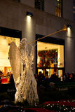 Christmas in new york - Rockefeller Center angels. New York, USA - December 3, 2015: Rockefeller Center Christmas decorations - angels with trumpets, with people royalty free stock photography