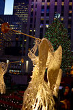 Christmas in new york - Rockefeller Center angels. New York, USA - December 3, 2015: Rockefeller Center Christmas decorations - angels with trumpets, with people stock photography
