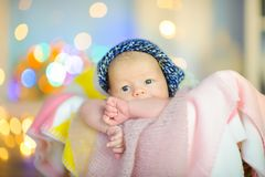 christmas, newborn, baby, background, white, beautiful, little, infant, lights, happy, new, cap, child, winter, small, xmas, year royalty free stock photos