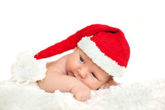 Christmas newborn baby in santa hat. Winter child on winter whit Stock Photos