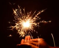 Christmas and newyear party sparkler on black. Close up Christmas and newyear party sparkler on black stock photos