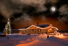 Christmas night. The house in village in Christmas night Stock Photo