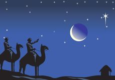 Christmas night. People travelling  on Camel in Christmas night  with moon and stars in the sky Stock Photo