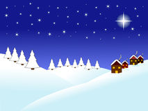 Christmas night. Winter scene at night, with bright stars,hills covered with snow and houses. It is a peaceful night just before Christmas Stock Photo