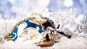 Christmas night, abstract holiday backgrounds. With carnival mask over wooden desk Royalty Free Stock Photo