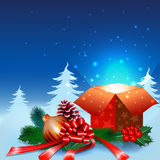 Christmas night background with gift box. And ornaments in the snow Royalty Free Stock Photos