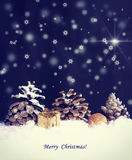 Christmas night background, pine cones, snowfall Royalty Free Stock Photography