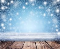 Christmas night background. A snowstorm and an empty table in th. Christmas Holiday Background, Christmas table background and blizzard. Christmas night. New royalty free illustration