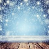 Christmas night background. A snowstorm and an empty table in th. Christmas Holiday Background, Christmas table background and blizzard. Christmas night.  New Royalty Free Stock Photos