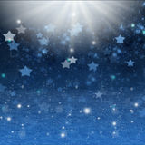 Christmas  night  background with stars and snow Royalty Free Stock Image