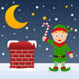 Christmas Night with Cute Elf. Happy cartoon Christmas elf character smiling and holding a candy cane on a snowy roof near a chimney. Eps file available stock illustration