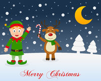 Christmas Night, Green Elf & Cute Reindeer. A merry Christmas greeting card with the trees, the moon, a happy green elf smiling and a cute reindeer holding a Royalty Free Stock Photography