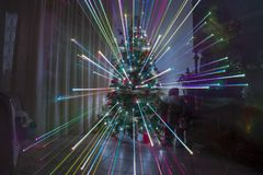 Christmas night at home with fireworks effect and rainbow lights christmas Royalty Free Stock Photography