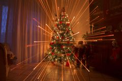 Christmas night at home with fireworks effect and warm lights Royalty Free Stock Photos