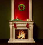 Christmas night interior with fireplace 3d rendering Stock Photography