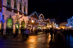 Christmas Night Leavenworth Bavarian Village. A Bavarian store lit up with Christmas lights at night with shoppers in beautiful Leavenworth, Washington, USA Stock Photos
