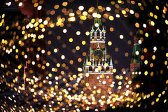 Christmas night Moscow atmosphere holiday background. Christmas night Moscow atmosphere with Kremlin Spassky Tower in center holiday background Stock Photos