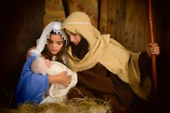 Christmas night nativity. Christmas nativity scene reenacted by children and a doll royalty free stock photo