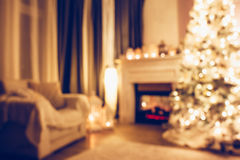 Christmas night in room. Beautiful holdiay decorated room with Christmas treem armchair and fireplace at night. Led lighting, cozy home scene. Nobody there. Out Royalty Free Stock Images