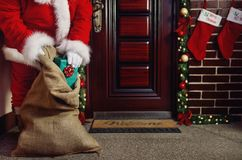 Christmas night, Santa Claus bring the Christmas present for chi Stock Image