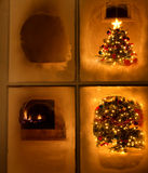 Christmas night time view of tree through frosted window still Stock Images