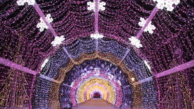 Christmas night on Tverskoy Boulevard in Moscow. Glowing decorative tunnel. Russia stock video