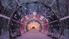 Christmas night on Tverskoy Boulevard in Moscow. Glowing decorative tunnel. Russia stock footage