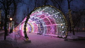 Christmas night on Tverskoy Boulevard in Moscow. Glowing decorative tunnel. Russia stock video footage