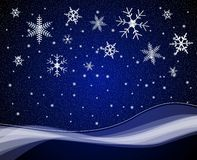 Christmas nightime snowfall Royalty Free Stock Images
