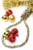 Christmas Noose. Noose made out of christmas rope, with baubles in the background, isolated on white Stock Images
