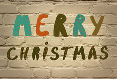 Christmas  note. Merry Christmas  note  on brick background Royalty Free Stock Photo