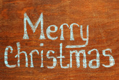 Christmas  note. Merry Christmas  note  on wood backgroundn Royalty Free Stock Image