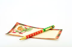 Christmas note and pen. Christmas note with Christmas pen isolated on white Stock Photography