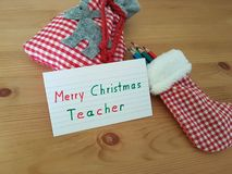 Christmas Note To Teacher With Stocking, Colored Pencils And Goody Bag stock photo