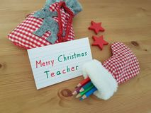 Christmas Note To Teacher With Stocking, Colored Pencils And Goody Bag stock image