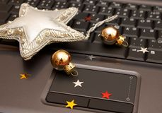 Christmas notebook-01. Christmas notebook, computer keyboard with gold sphere Stock Photography