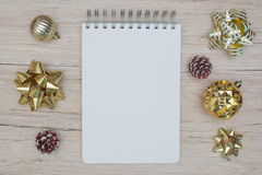 Christmas notepad on wooden table with decorations. Stock Image