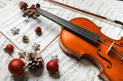 Close-up Photo Of Violin, Musical Notes and. Christmas notes violin balls play graphic paper stock photo