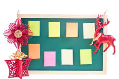 Christmas notice board with ornaments over white Stock Image