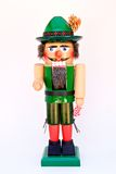 Christmas Nut Cracker. Germ wooden nut cracker dressed in green stock photography